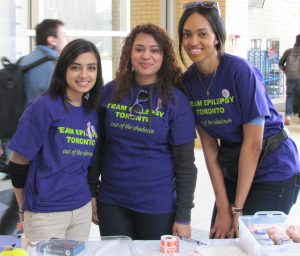 Students at an epilepsy information table.