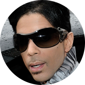 Photo of Prince wearing sunglasses.
