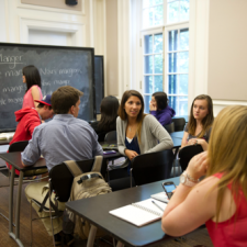 Students having a discussion in a classroom.